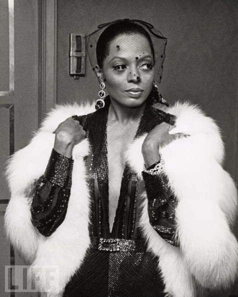 Diana-ross-in-a-white-fur-and-plunging-neckline-makes-a-timeless-fashion-statement