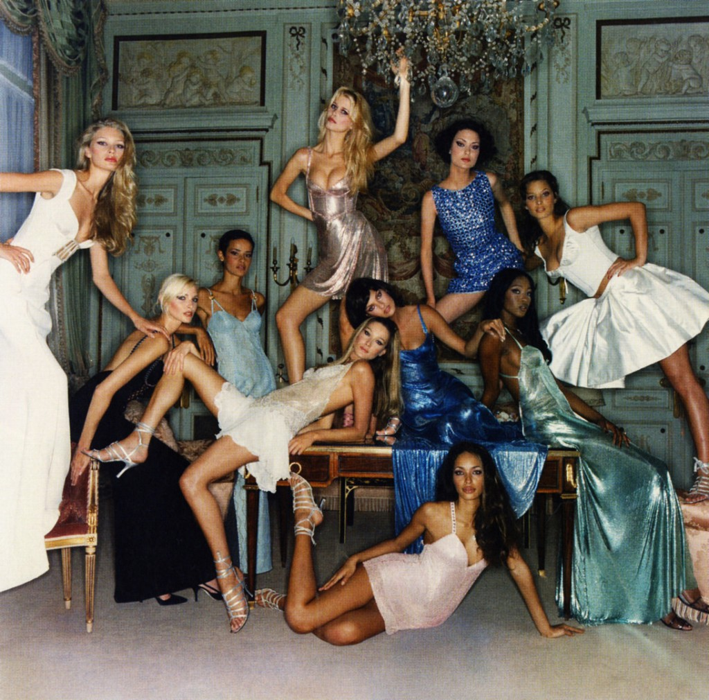Kristy Hume, Nadja Auermann, Nadege du Bospertus, Carla Bruni, Linda Evangelista, Claudia Schiffer, Shalom Harlow, Naomi Campbell, Christy Turlington, Brandi Quinones all in Versace photographed by Michel Comte for Vogue Italia in 1994