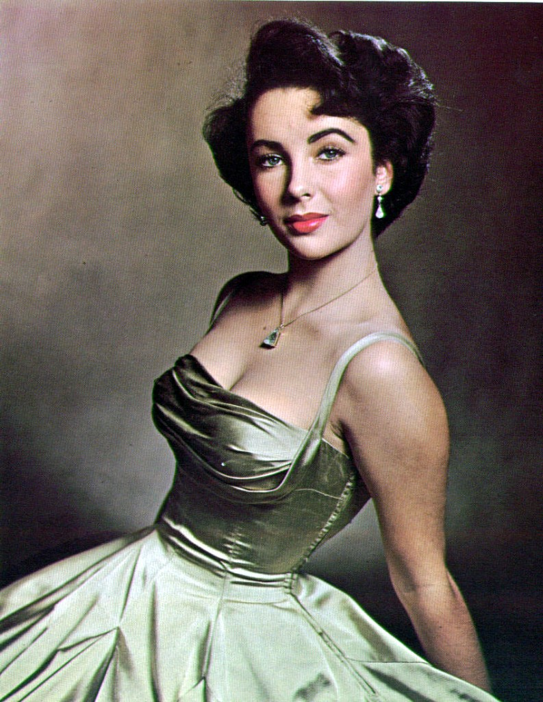 elizabeth-taylor-almost-17-sits-for-photographer-phillippe-halsman-in-a-decollete-evening-dress-of-gold-silk