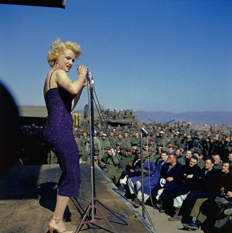Marilyn Monroe Speaking to Troops at Microphone