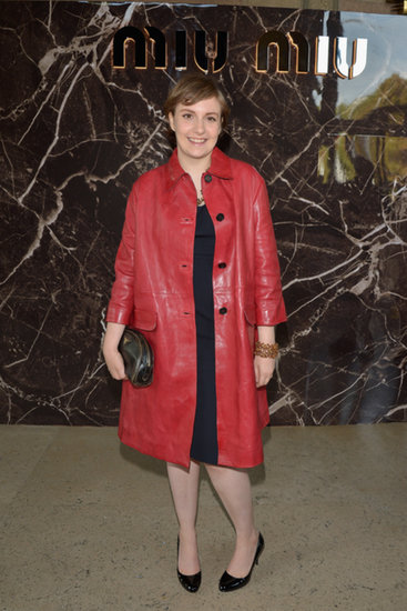 Lena-Dunham-rocked-head--toe-Prada-ensemble-Miu-Miu-show-She-started-little-black-dress-added-red-leather-coat-crystal-jewels-black-clutch-patent-pumps
