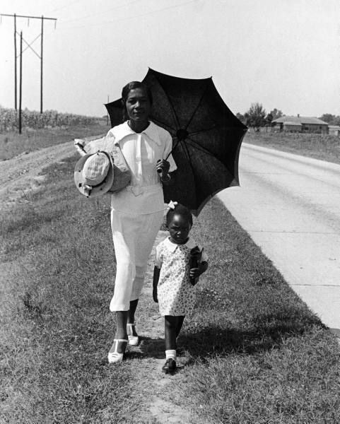 Woman walking her daughter to Sunday school on a road between Memphis, TN and Clarksdale, MS. Alfred Eisenstaedt, 1938.