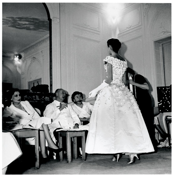 1954 - Christian Dior Prepares the 1955 AutumnWinter collection. Model wearing the 'Première soirée' dress