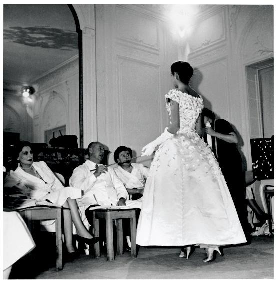 1954 - Christian Dior Prepares the 1955 AutumnWinter collection. Model wearing the 'Première soirée' dress