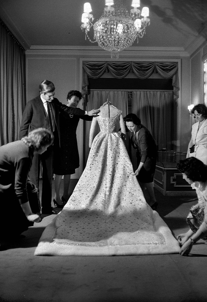Yves Saint Laurent put the finishing touches on Farah Diba's wedding dress in December 1959.