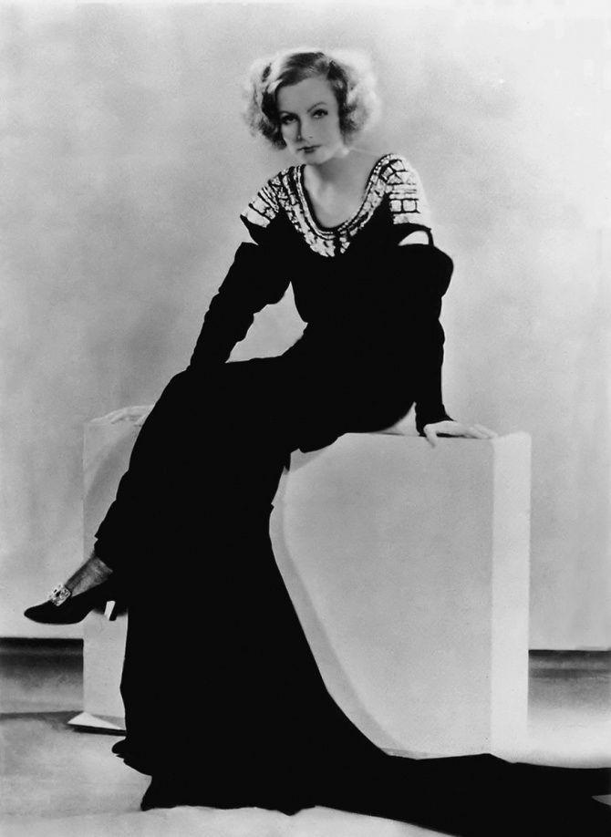 Greta Garbo in evening dress designed by Gilbert Adrian, c.1931.