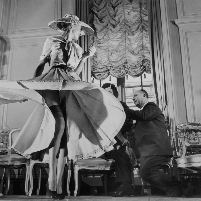 Stockings were highlighted for the first time when Christian Dior (right), noted French designer, exhibited his French collection. ' March 11, 1948 Paris, France