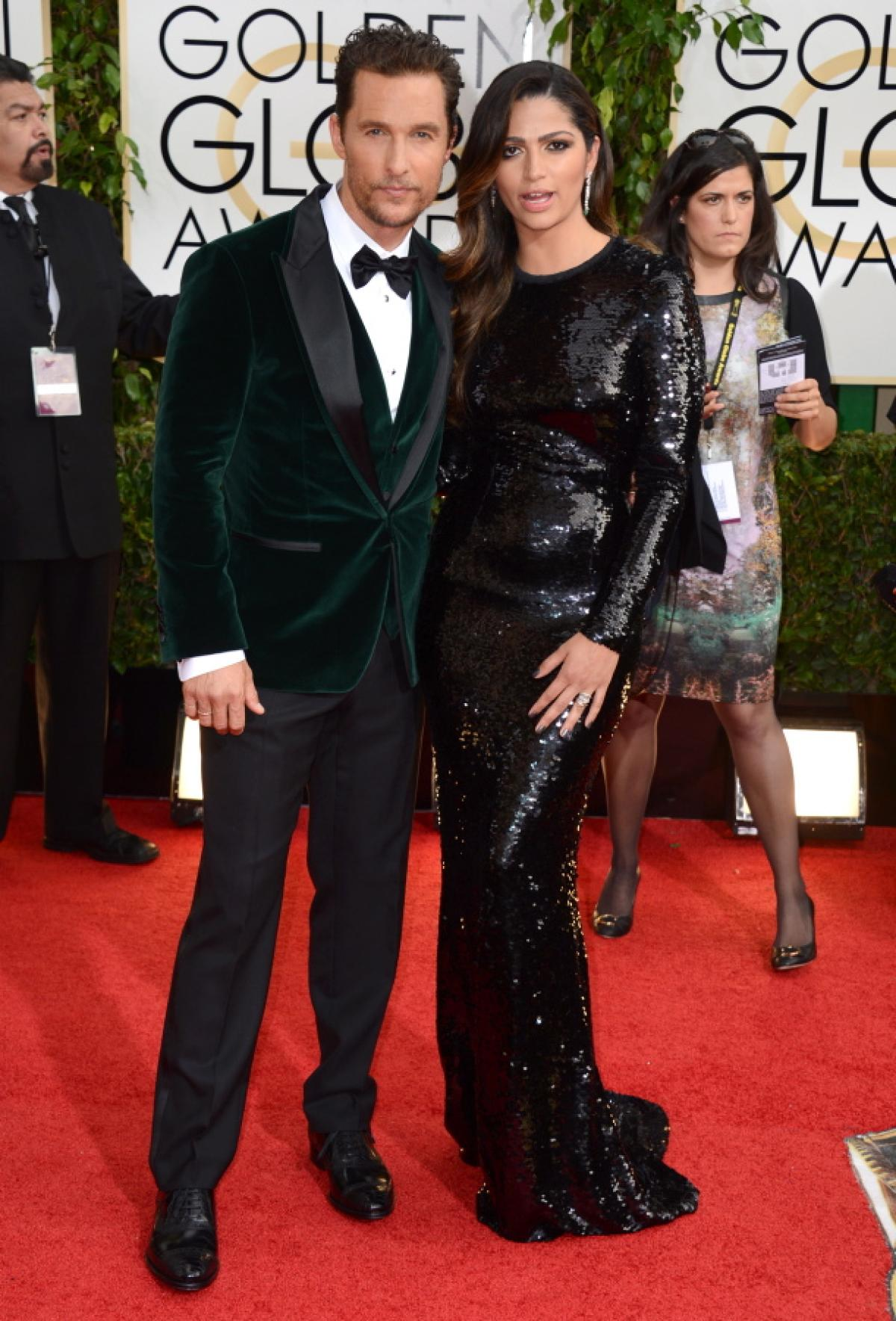 Matthew Mcconaughey in a green velvet with black bowtie and Camila Alves in sequin D & G dress