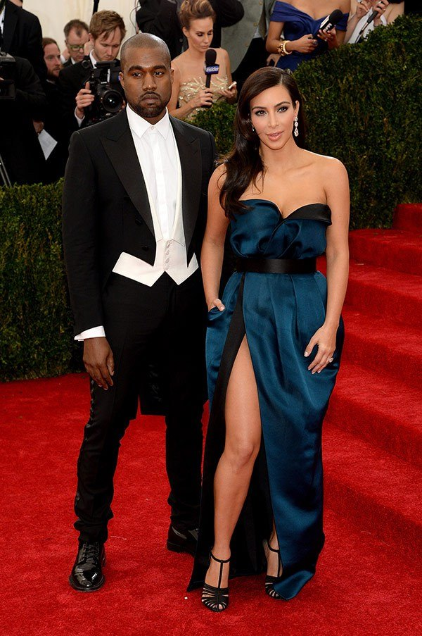 Fashion Sizzle Liked · 6 hrs Kim Kardashian and Kanye West in Lanvin.