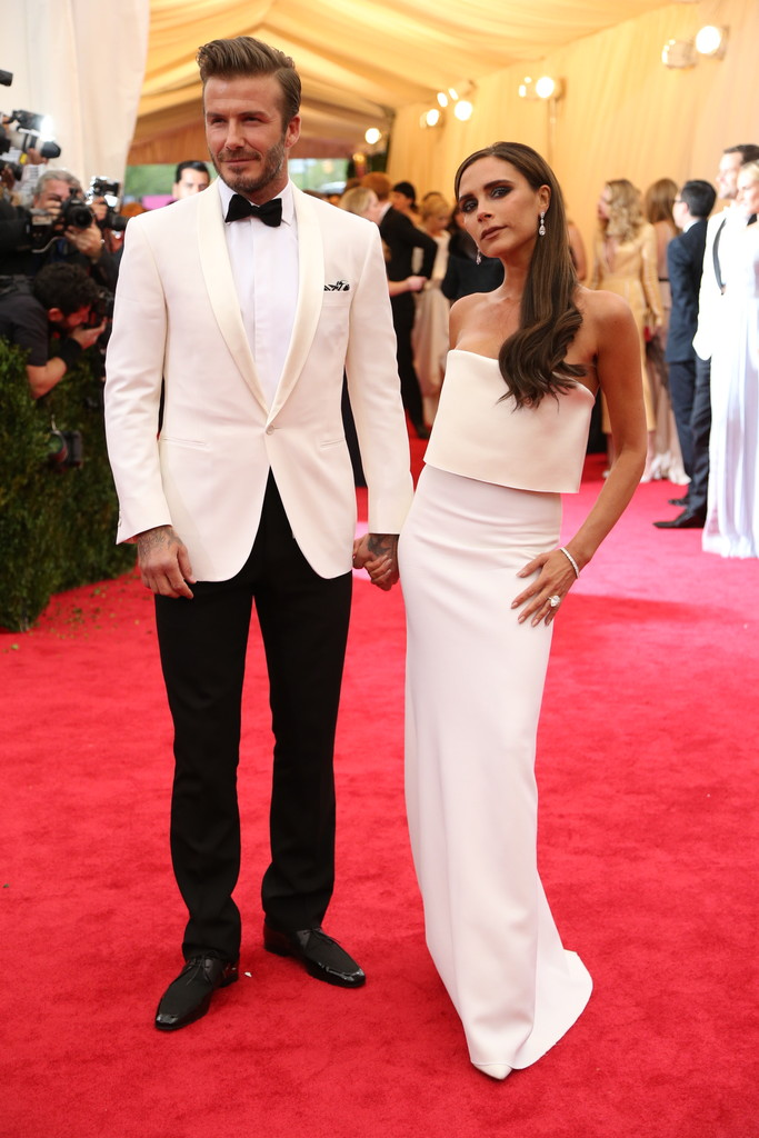 David Beckham in Ralph Lauren and Victoria Beckham in a dress from her own collection.