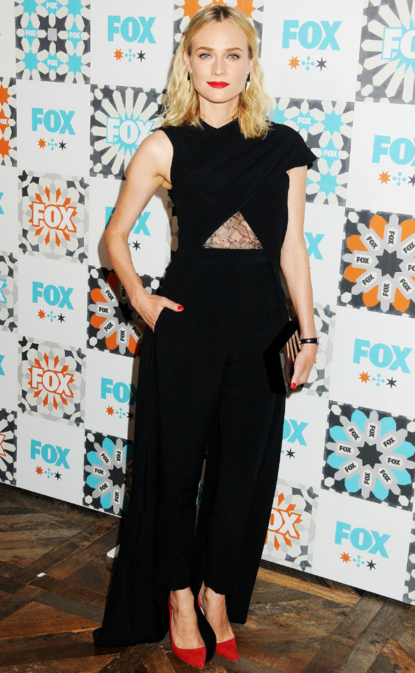 Diane Kruger in a black Marios Schwab jumpsuit with lace cutout
