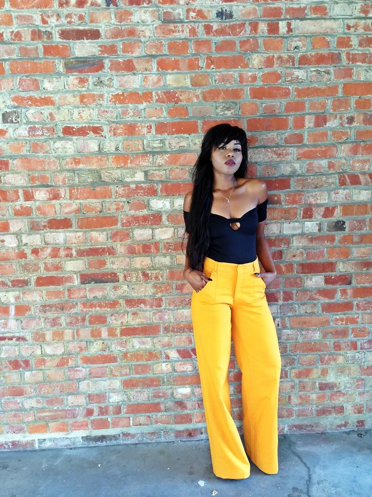 Of the shoulder top and yellow wide leg pants