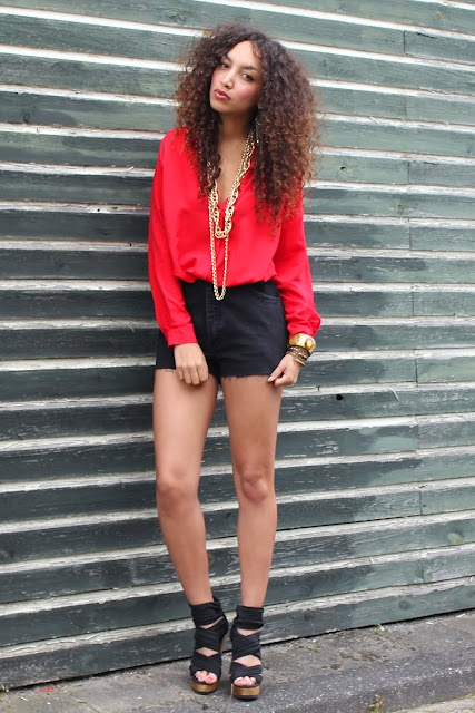 Red blouse and black shorts with black shoes