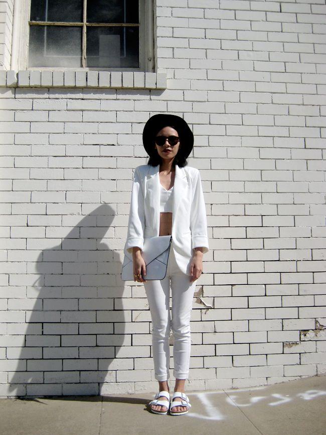 Black hat, white crop top jacket and pants