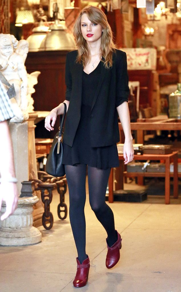 Taylor Swift in a black Jacket, blouse , mini skirt tights, witha Black Vintage bag and Burgundy shoes
