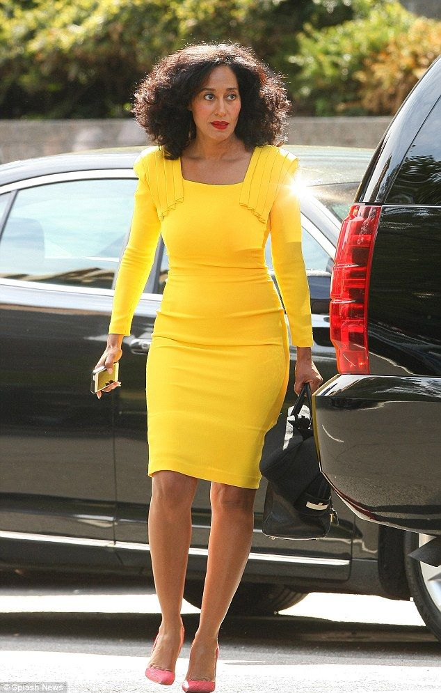 Tracee Ellis Ross rocking a yellow body con dress