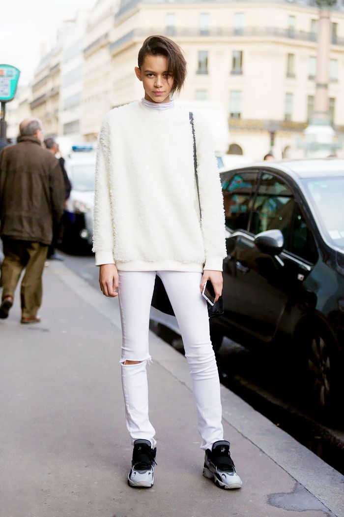 Model Binx Walton gets comfy in a fuzzy sweater, white jeans, and sneakers