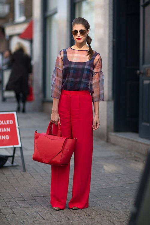 sheer plaid blouse, flared pants and red bag
