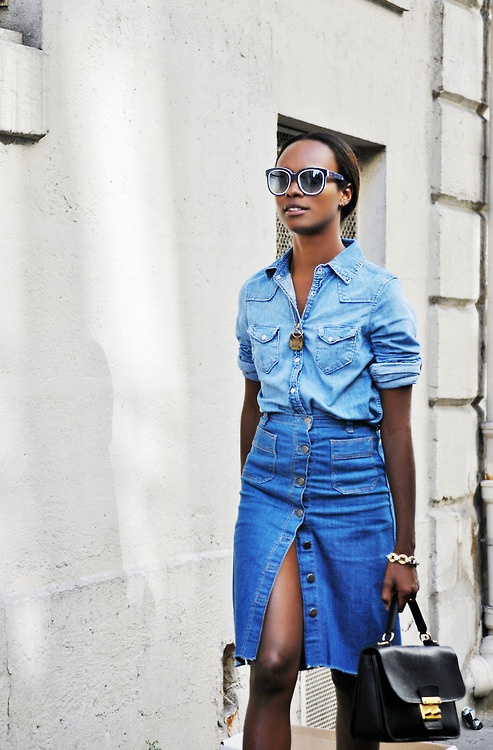 long sleeve rolled up denim blouse with a buttoned denim skirt and black bag