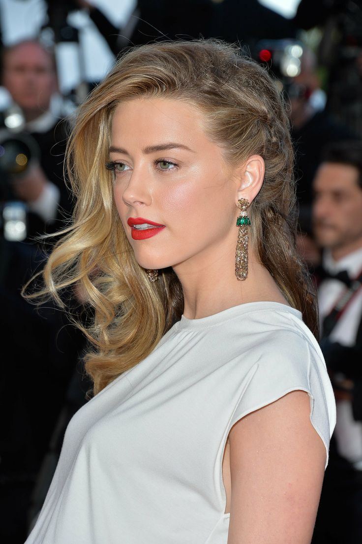 Amber Heard attended the Cannes debut of Two Days, One Night, rocking her hair braided to the side