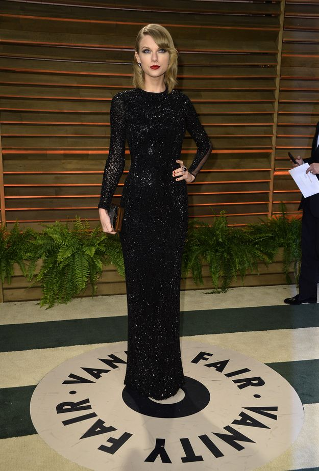 Taylor Swift in a Julien Macdonald dress, Emm Kuo clutch, Tamara Mellon shoes, and Lorraine Schwartz jewelry at the 2014 Oscars After-Party Dresses