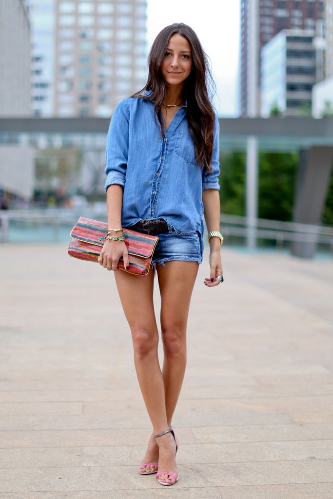 Denim Blouse and shorts with a clutch bag and heels