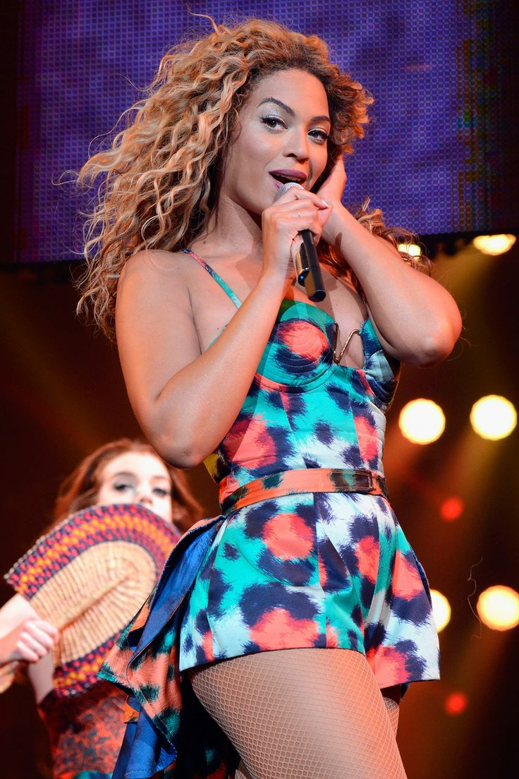 """Beyonce on stage during """"The Mrs. Carter Show World Tour"""" at the Barclays Center on August 3, 2013 in New York, New York. Beyonce wears a printed halter with a tiered skirt and shoes by Kenzo and hosiery by Capezio."""