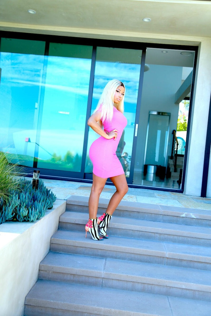Nicki Minaj rocking a pink bodycon dress and printed shoes