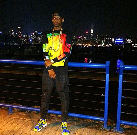 Rapper Fabolous is rocking a $285 Hood by Air Weather Map-Print Tee-Shirt with a with black quilted sweatpants and royal and yellow Addias sneakers