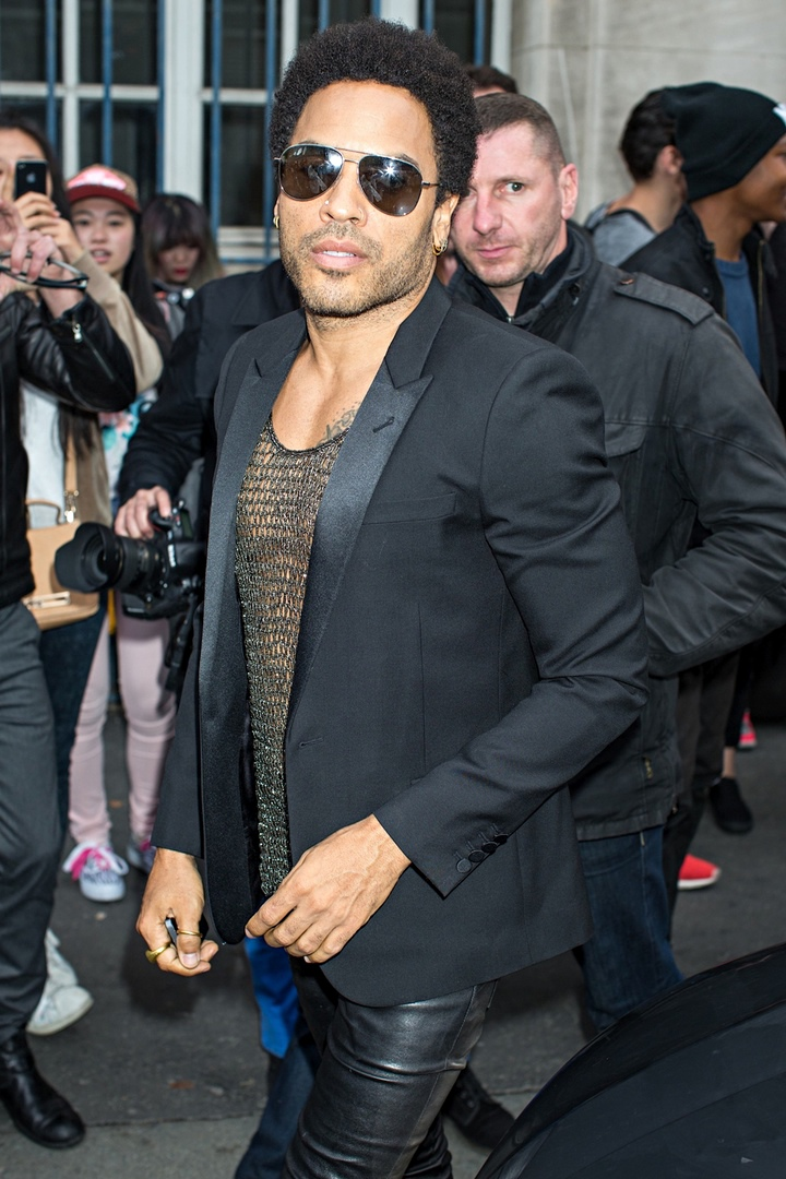 Lenny Kravitz arriving at Saint Laurent menswear Spring/Summer 2015 show in Paris rocking leather pants , a metallic vest and a black tuxedo jacket ,