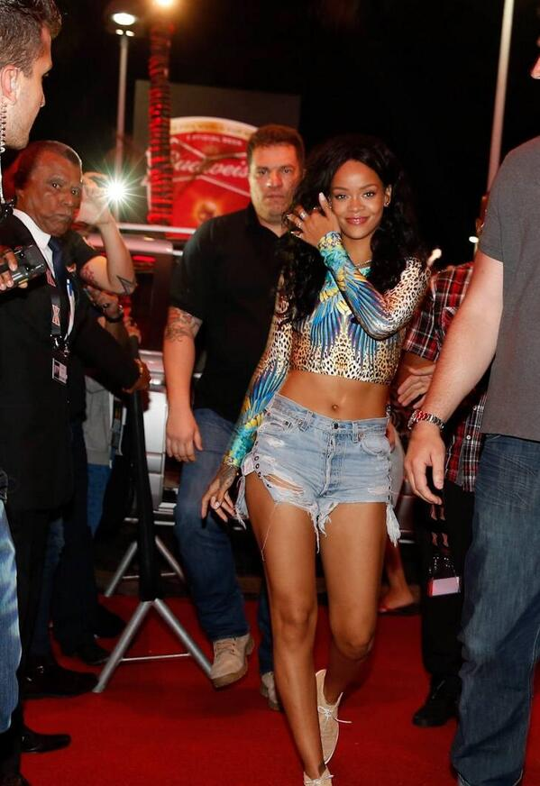 Rihanna in Brazil rocking an animal print swimsuit crop top by Brazilian brand Cia Maritima.,cut off shorts distressed denim shorts and , $395 Robert Clergerie Poco raffia Oxford shoes.