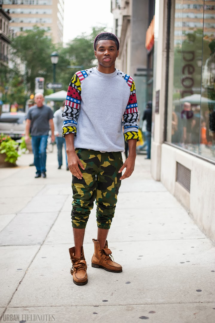 Camouflage pants ,boots and sweater with printed sleeves