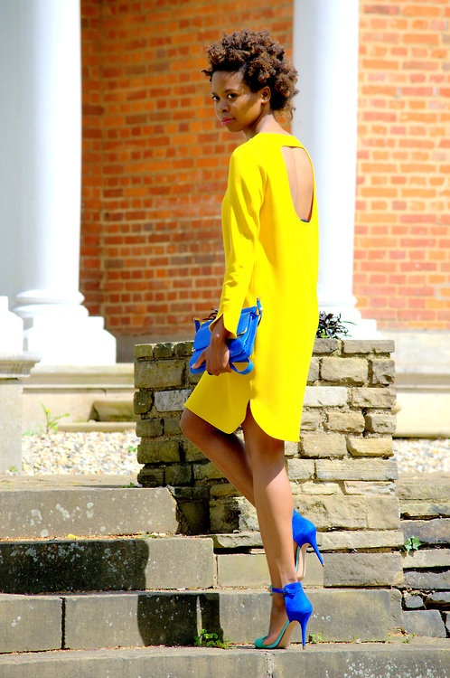 Cut out back Yellow dress with blue shoes and bag