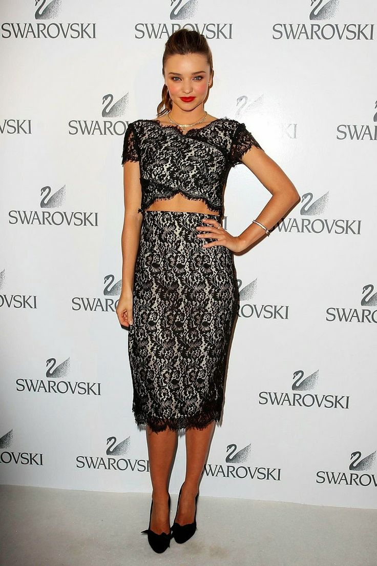 Miranda Kerr in a lace crop top and pencil skirt