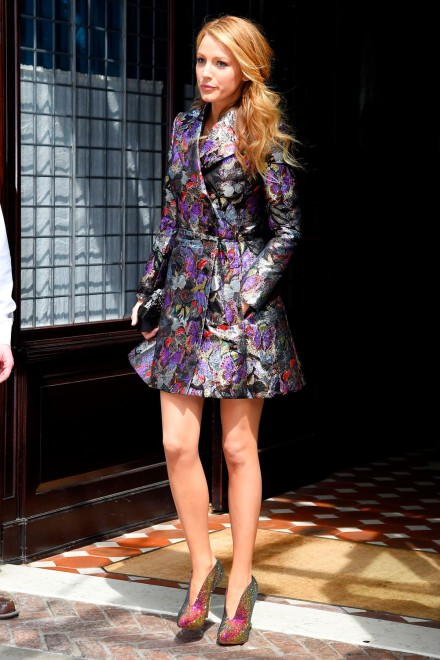 Blake Lively leaving her hotel in Greenwich Village wearing a printed coat by Valentino. May 2014