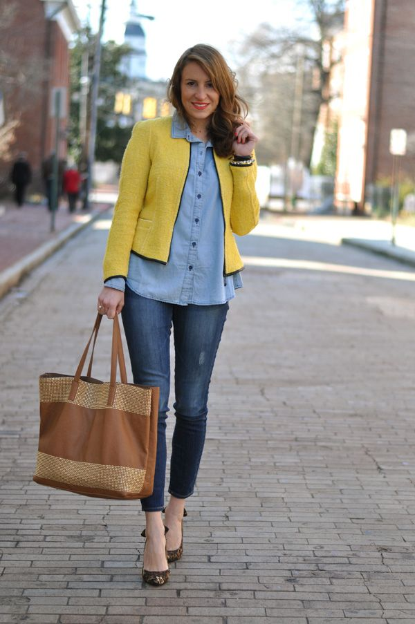 Denim on denim rocked with with a cropped yellow blazer and oversized bag