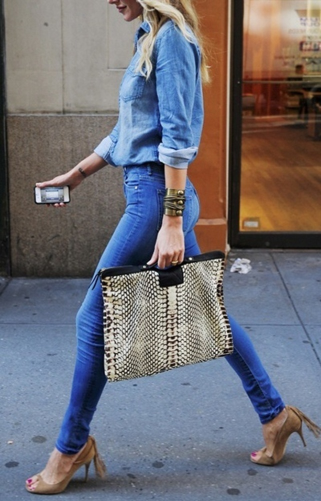 with an Oversized clutch and nude shoes