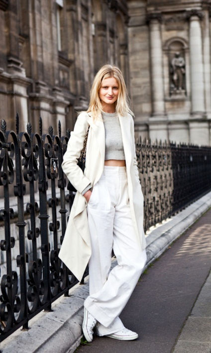 Wide leg pants , long coat, crop top and tonal whites.