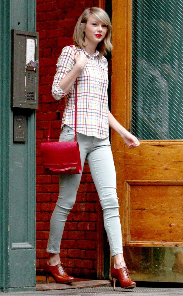 Taylor Swift rocking a plaid shirt , colored skinny jeans , red shoes and cranberry bag