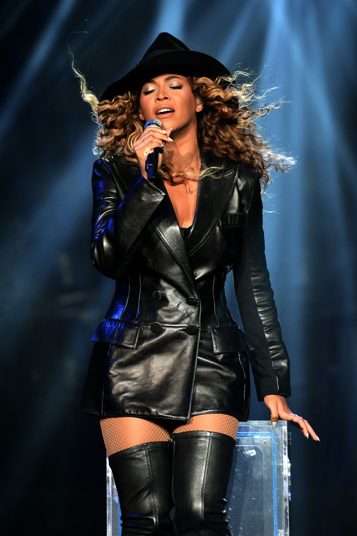 """Beyonce performs on stage during """"The Mrs. Carter Show World Tour"""" at the Mohegan Sun Arena on August 2, 2013 in Uncasville, Connecticut. Beyonce wears a coat by Pucci and hosiery by Capezio."""