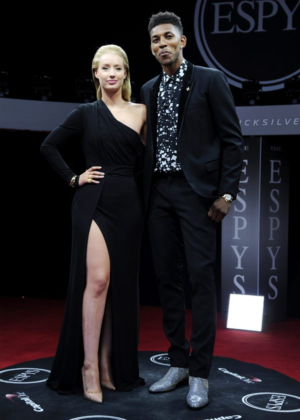 Iggy Azalea (L) and NBA player Nick Young attend The 2014 ESPY Awards at Nokia Theatre L.A. Live on July 16, 2014 in Los Angeles, California. (Photo by Kevin Mazur/WireImage)