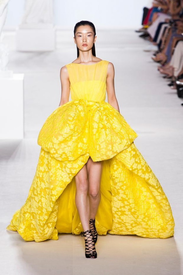 Lupita is wearing a yellow haute couture gown from the Fall 2013 Giambattista Valli