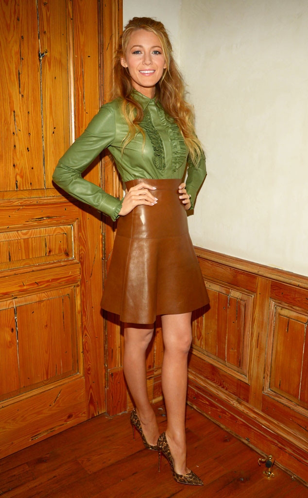 Blake Lively in a green frill Gucci blouse and brown leather skirt