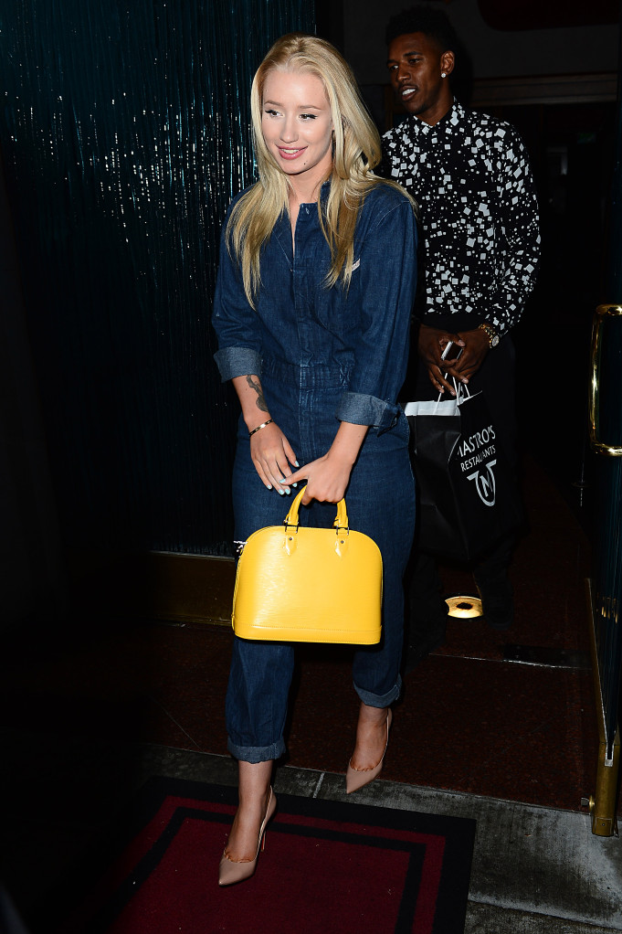 Iggy Azalea had dinner with boyfriend Nick Young rocking a denim Calvin Klein jumpsuit, a pair Of $625 Christian Louboton Decolite pumps and a yellow Louis Vuitton Leather Alma PM Handbag. Nick is rocking a $950 YSL Square Black and white Print Silk Shirt