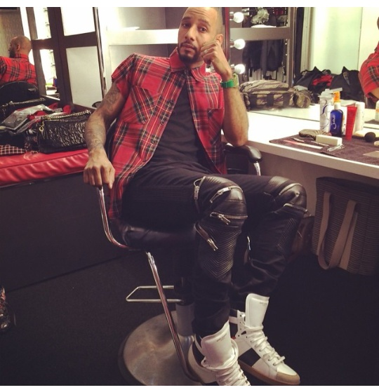 Swizz Beatz styled for a photo shoot rocking a $395 Fear of God LA Flannel , a $949 Saint Laurent Leather & Denim Biker Jeans and a $656 Saint Laurent Hi-Top Sneakers