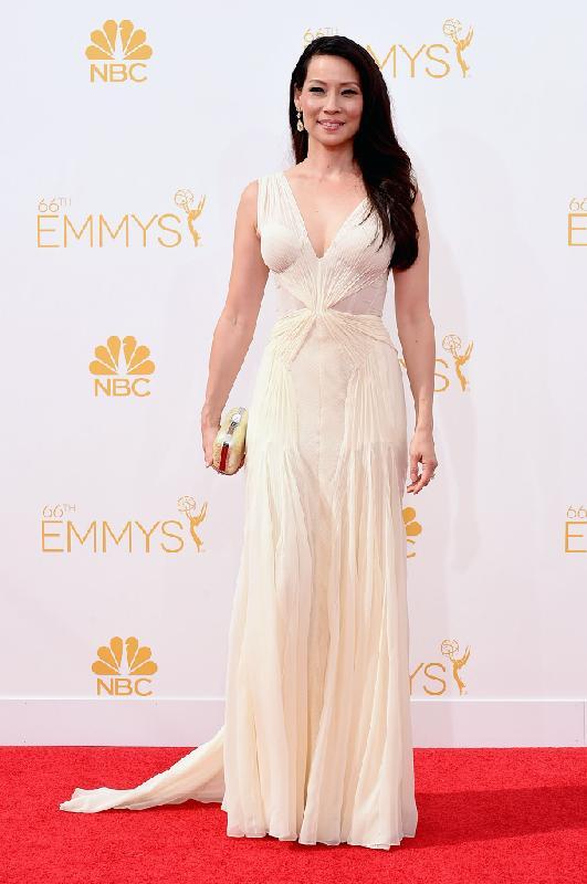 Lucy Liu in off-white Zac Posen dress and sleek strands. Liu, 45, completed her elegant ensemble with Lorraine Schwartz jewelry and a Jimmy Choo clutch.