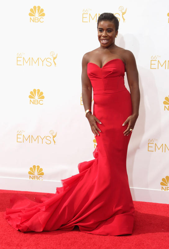 Uzo Aduba in a a strapless red chiffon dress with a train that has ruffles