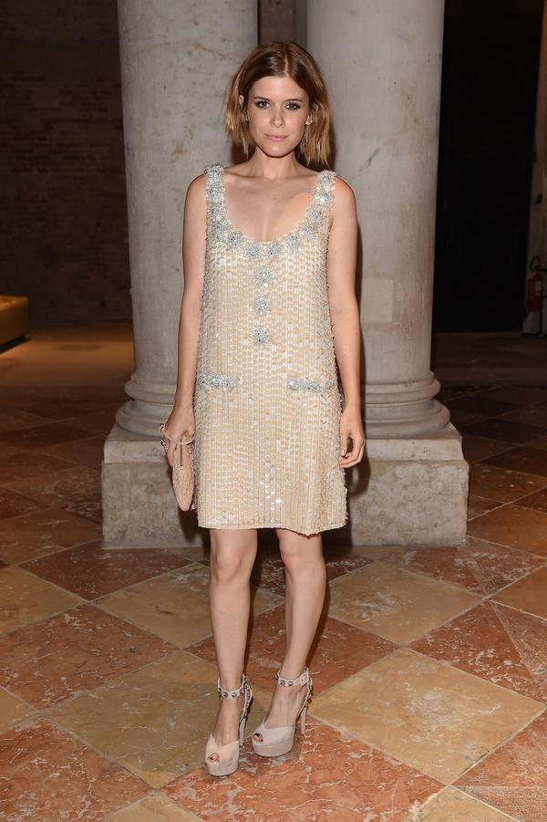 Kate Mara at the Miu Miu Women's Tales dinner in Venice wearing a nude sleeveless textured Miu Miu dress with allover paillettes and a , decorative neckline.