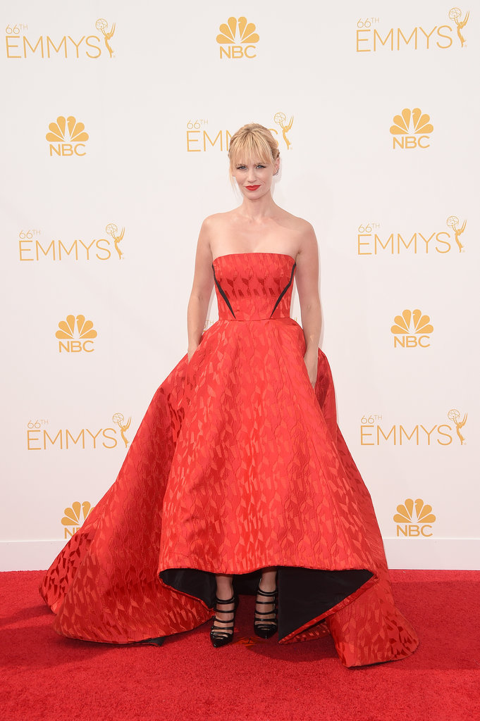 January Jones in strapless red Prabal Gurung with black piping that cuts into the waist, also loved the raised hemline in the front of the dress.