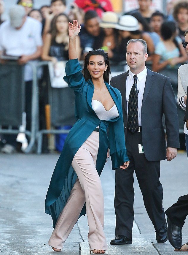 Kim-Kardashian-In-Ulyana-Sergeenko-Spring-2014-Couture-Emerald-Green-Silk-Jacket-and-Pink-Trousers-on-Jimmy-Kimmel-Live-9